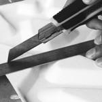 Repetir el corte inicial por un corte profundo en el panel.